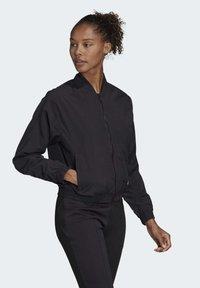 adidas Performance - WOVEN BOMBER JACKET - Training jacket - black - 2