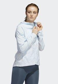 adidas Performance - OWN THE RUN HD WINDBREAKER - Waterproof jacket - blue - 0