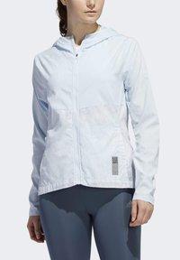 adidas Performance - OWN THE RUN HD WINDBREAKER - Waterproof jacket - blue - 3