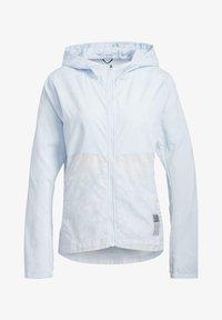 adidas Performance - OWN THE RUN HD WINDBREAKER - Waterproof jacket - blue - 8
