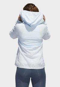 adidas Performance - OWN THE RUN HD WINDBREAKER - Waterproof jacket - blue - 1