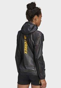 adidas Performance - TERREX AGRAVIC RAIN JACKET - Waterproof jacket - black - 1