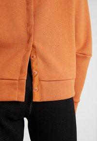 adidas Performance - Jersey con capucha - copper - 4