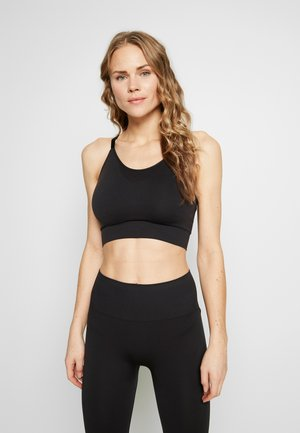 SEAMLESS BRA - Sports bra - black