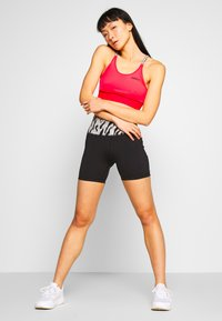 adidas Performance - Sports bra - corpnk/black - 1