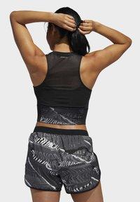 adidas Performance - OWN THE RUN CITY CLASH  - Sports-BH - black - 1
