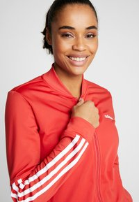 adidas Performance - ESSENTIALS 3STRIPES SPORT TRACKSUIT - Chándal - glow red - 5