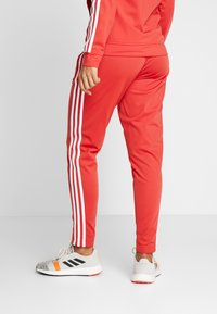 adidas Performance - ESSENTIALS 3STRIPES SPORT TRACKSUIT - Chándal - glow red - 4