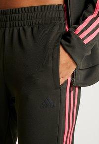 adidas Performance - TEAM SPORTS - Tracksuit - legear/black/reapink - 8