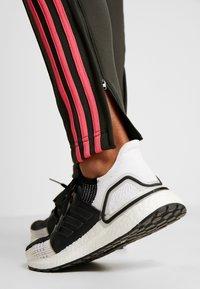 adidas Performance - TEAM SPORTS - Tracksuit - legear/black/reapink - 6