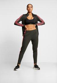 adidas Performance - TEAM SPORTS - Tracksuit - legear/black/reapink - 1