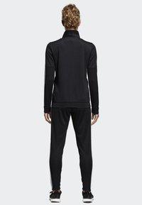 adidas Performance - TEAM SPORTS - Tracksuit - black/white - 1