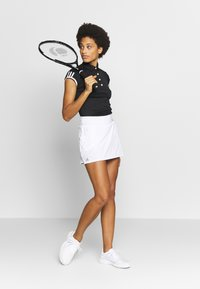 adidas Performance - CLUB SKIRT - Sportovní sukně - white/black - 1