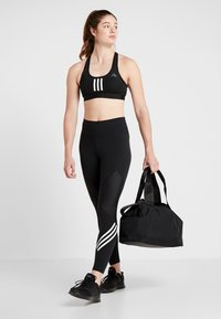 adidas Performance - Sports bag - black - 1