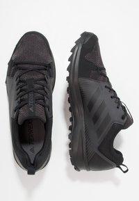 adidas Performance - TERREX TRACEROCKER TRAIL RUNNING SHOES - Löparskor terräng - core black/utility black - 1