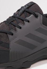 adidas Performance - TERREX TRACEROCKER TRAIL RUNNING SHOES - Löparskor terräng - core black/utility black - 5