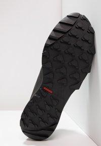 adidas Performance - TERREX TRACEROCKER TRAIL RUNNING SHOES - Löparskor terräng - core black/utility black - 4