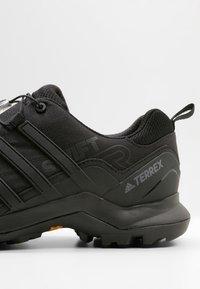 adidas Performance - TERREX SWIFT R2 HIKING SHOES - Hiking shoes - coren black - 5