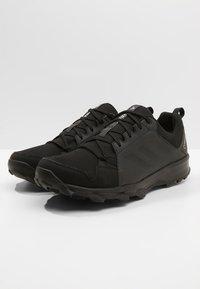 adidas Performance - TERREX TRACEROCKER GORE TEX TRAIL RUNNING SHOES - Hiking shoes - core black/carbon - 2
