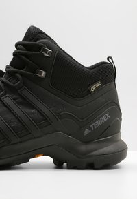 adidas Performance - TERREX SWIFT R2 MID GORE TEX HIKING SHOES - Hiking shoes - core black - 5