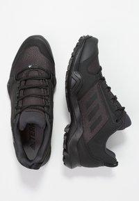adidas Performance - TERREX AX3 - Hiking shoes - core black/carbon - 1