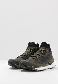 adidas Performance - TERREX FREE HIKER - Zapatillas de senderismo - raw khaki/core black - 2