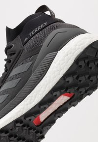 adidas Performance - TERREX FREE HIKER - Hiking shoes - core black/grey six/active orange - 5