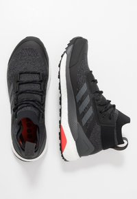 adidas Performance - TERREX FREE HIKER - Hiking shoes - core black/grey six/active orange - 1