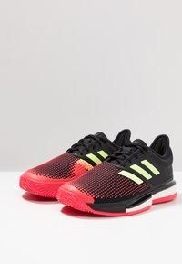 adidas Performance - SOLECOURT BOOST CLAY - Tennisskor för grus - core black/hi-res yellow/shock red - 2