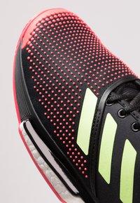 adidas Performance - SOLECOURT BOOST CLAY - Tennisskor för grus - core black/hi-res yellow/shock red - 5