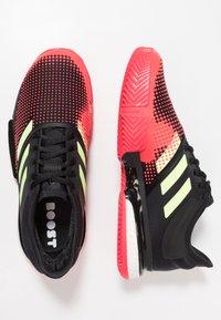 adidas Performance - SOLECOURT BOOST CLAY - Tennisskor för grus - core black/hi-res yellow/shock red - 1