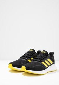 adidas Performance - RUNFALCON - Hardloopschoenen neutraal - core black/shock yellow/footwear white - 2