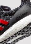adidas Performance - ULTRABOOST - Hardloopschoenen neutraal - clear black/scarle/grethr