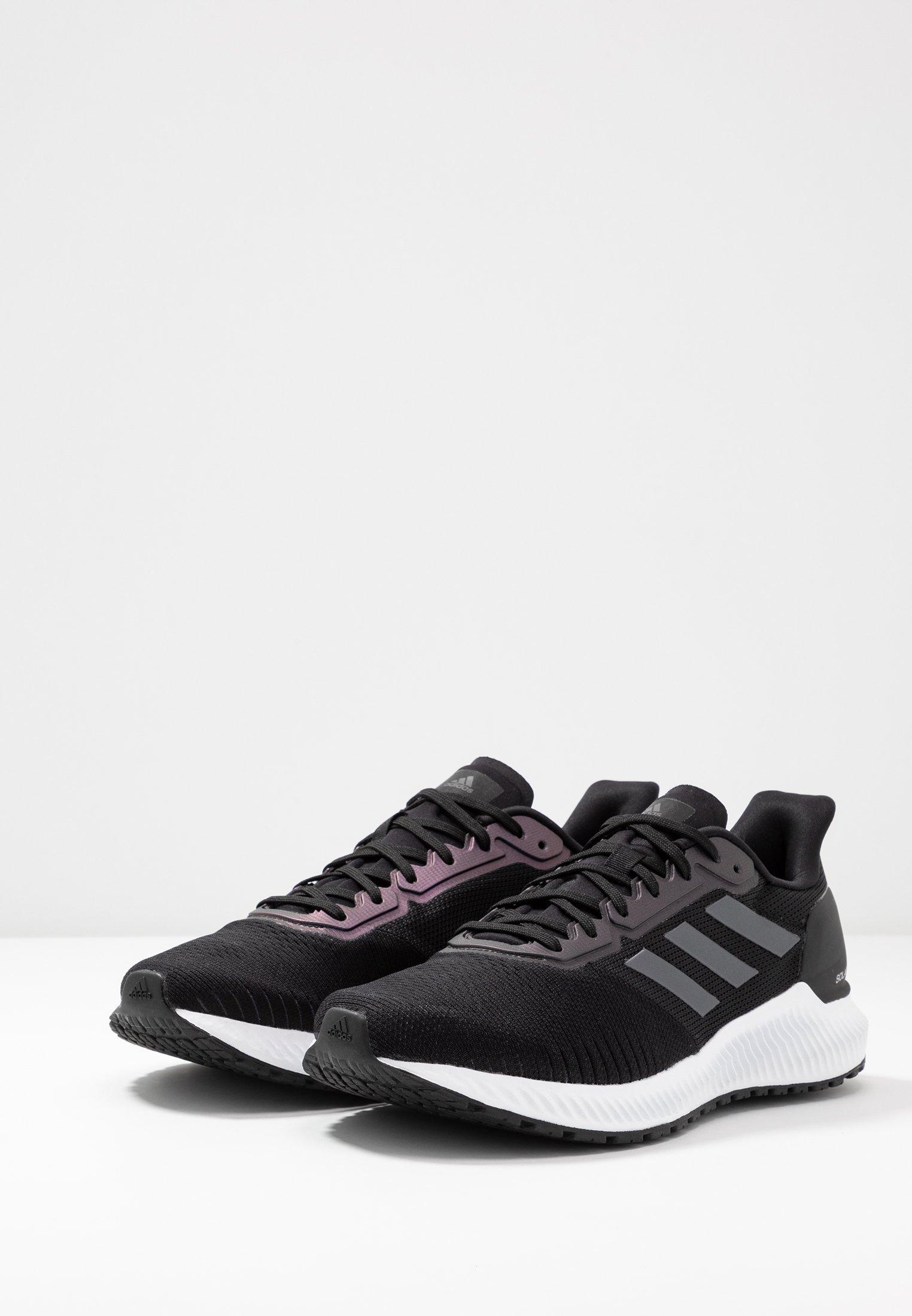 adidas Performance SOLAR RIDE - Laufschuh Neutral - core black/night metallic/footwear white - Black Friday