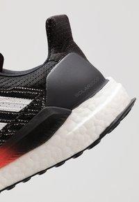 adidas Performance - SOLAR BOOST 19 - Zapatillas de running neutras - core black/footwear white/solar red - 5