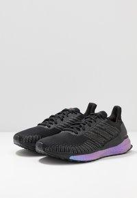 adidas Performance - SOLAR BOOST 19 - Zapatillas de running neutras - core black/solar red - 2