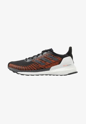 SOLAR BOOST ST 19 - Stabilty running shoes - core black/grey five/solar orange