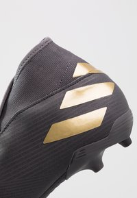 adidas Performance - NEMEZIZ 19.3 LL FG - Chaussures de foot à crampons - core black/gold metallic/utility black - 5