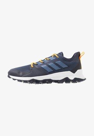 KANADIA - Běžecké boty do terénu - trace blue/tech ink/active gold