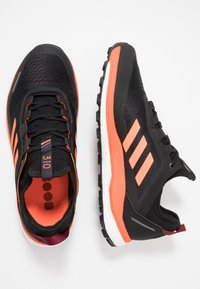 adidas Performance - TERREX AGRAVIC FLOW TRAIL RUNNING SHOES - Løpesko for mark - collegiate burgundy/solar orange/core black - 1