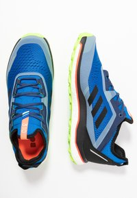 adidas Performance - TERREX AGRAVIC FLOW - Trail running shoes - glow blue/core black - 1