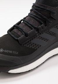 adidas Performance - TERREX FREE HIKER GORE TEX HIKING SHOES - Hiking shoes - core black/grey three/active orange - 5