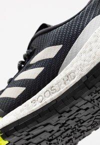 adidas Performance - PULSEBOOST HD PRCT - Hardloopschoenen neutraal - core black/grey two/solar yellow - 5