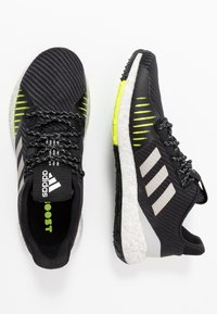 adidas Performance - PULSEBOOST HD PRCT - Hardloopschoenen neutraal - core black/grey two/solar yellow - 1
