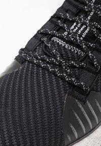 adidas Performance - PULSEBOOST HD PRCT - Neutrala löparskor - core black/grey six/solar red - 5