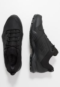 adidas Performance - TERREX AX3 BETA CLIMAWARM HIKING SHOES - Hiking shoes - core black/grey five - 0