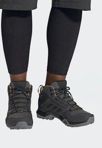 adidas Performance - TERREX AX3 MID GORE TEX HIKING SHOES - Hiking shoes - grey/ black - 0