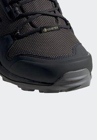 adidas Performance - TERREX AX3 MID GORE TEX HIKING SHOES - Hiking shoes - grey/ black - 7