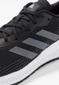 adidas Performance - SOLAR BLAZE - Minimalist running shoes - core black/grey five/footwear white - 5