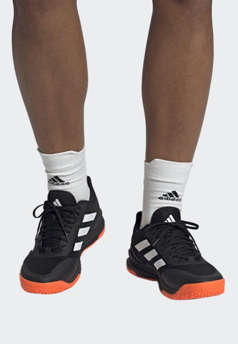 adidas Performance - STABIL BOUNCE SHOES - Håndboldsko - black/white/orange